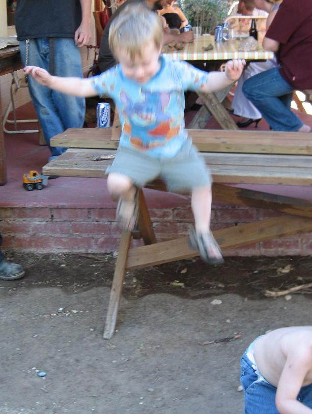 Here a second shot Dylan jump off the picnic table midair