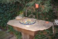 Mitch's custom made outdoor marble top with Mexican sink and custom cupper faucets