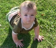 Aiden Crawling on the grass circa May 2010