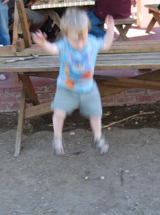 Dylan jumping off the picnic table just over 2 years old