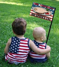 Two young children holding an Aquaponics USA flag