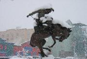 Picture of a statute of a rider on a horse outside a hotel Reno, NV snow storm 2004